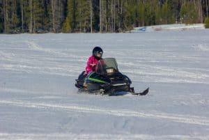 snowmobiling on Helmer Lake